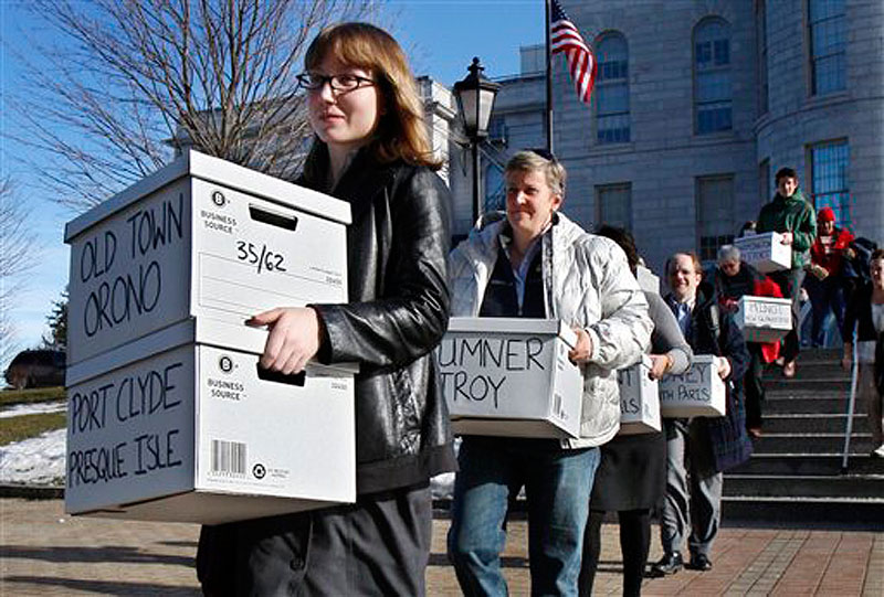 In this Thursday, Jan. 26, 2012 photo, Whitney Gifford, of Bucksport, Maine, leads a group of gay marriage supporters carrying signed petitions to the Secretary of State's office in Augusta, Maine. The Defense of Marriage Act, prevents gay married couples from receiving marriage benefits, is heading to a federal appeals court in Massachusetts. (AP Photo/Robert F. Bukaty)