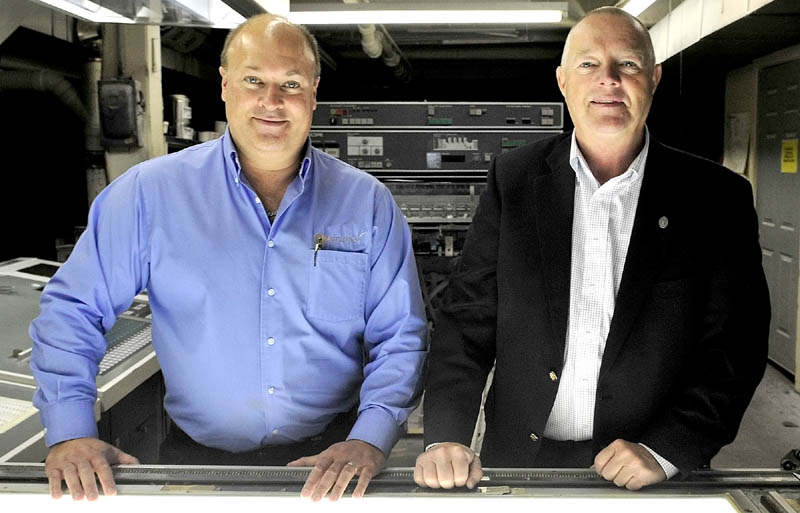 IN BUSINESS: Peter Schutte, left, and Mike Whitman inside the former Atkins Printing company in Waterville on Thursday. The men formed the Premier Color company, which will do business as Atkins Printing Services.