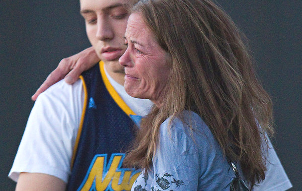 Jacob Stevens, 18, hugged his mother, Tammi Stevens, after being interviewed by police outside Gateway High School in Denver.