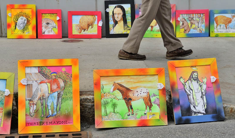The art work of John Salemi lines the side walk on Main Street in Waterville during the Intown Arts Festival on Saturday.