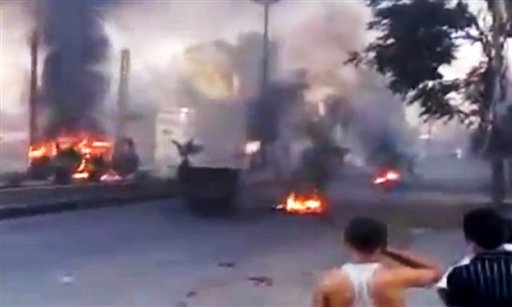 This image from amateur video released by the Ugarit News purports to show burning tires in Damascus. Anti-regime activists say government forces are shelling a number of neighborhoods in and around the capital a day after a bomb killed three members of President Bashar Assad's inner circle.