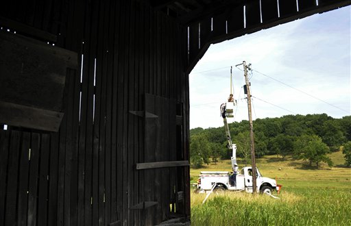 A Gulf Power lineman works to restore a power line near a barn in Middleburg, Va., Tuesday. Severe storms swept through the region, leaving many homes and businesses without electricity.