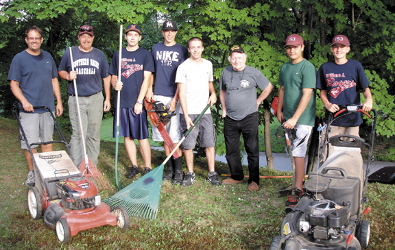 Contributed photo Pictured from left to right: Ryan Karkas, coach Troy Crane, Nate Pushard, Brian Crane, Tucker Beaudion, Emmitt Stuart, Brandon Dubue, and Kyle Karkos. Seven members of the American Legion Baseball Team post 153, spent a sunny day giving back to the American Legion? The team players woke up bright and early to give back to their community and to veterans. This time it wasn�t baseball bats, balls and gloves they were handling but rather a lawn mower, weed wacker, rake, a chain saw and an eager attitude. They spent the day mowing, raking, bagging and cutting up small fire wood for Veteran, Emmett Stuart. The team players wanted to show their appreciation for participating in the American Legion 2012 Baseball season. They called the post to inquire on what could be done. Past Commander Hugh Brown suggested helping past Commander Emmitt Stuart who served as a commander for several terms and was instrumental in sending supplies to the troops in Iraq and Afghanistan. Stuart has been a long time member of the American Legion and the VFW and has strongly supported both veteran organizations stated Brown. Community service has long been a requirement to graduate from certain high schools across the country and community service is always a winner for everyone involved stated Brown. For information on the 2013 American Legion Baseball season contact Tibby Dupuis at the William J. Rogers post home at 1-(207) 782-1118 or email us at ampost153auburn@gmail.com or at legionpost153me.org
