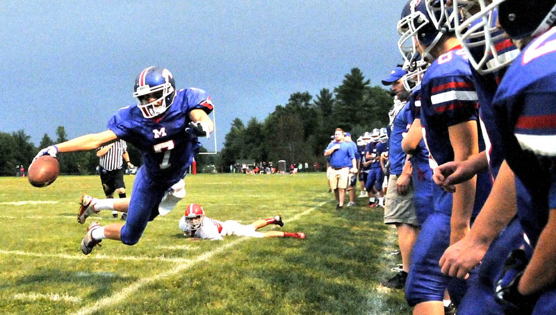 Messalonskee High School's Jake Dexter, 7, dives for a first down in the first quarter against Cony High School at Messalonskee High School in Oakland.