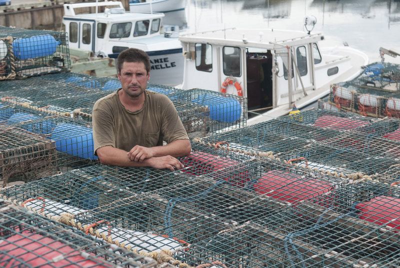 """Jean-Pierre Cormier, the spokesman for a group of lobstermen on Aboiteau Wharf in Cap-Pele, New Brunswick, says, """"We can't fish for $2.50 a pound. How do you make a living on that?"""""""