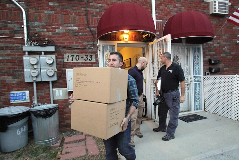 Law enforcement officials remove boxes of potential evidence from the New York home where Quazi Mohammad Rezwanul Ahsan Nafis was staying, Wednesday, Oct. 17, 2012. Nafis was arrested in an FBI sting operation earlier in the day after attempting to blow up a fake car bomb outside the Federal Reserve building in Manhattan, authorities said. (AP Photo/Newsday, Howard Schnapp)