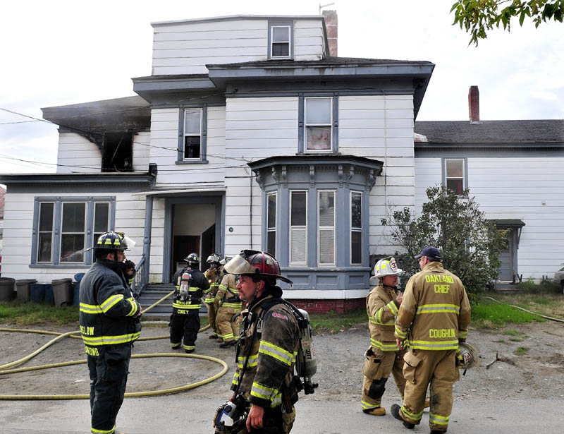Firefighters from several area departments extinquish a fire that caused serious damage to an apartment building on Western Avenue in Waterville late Tuesday afternoon.