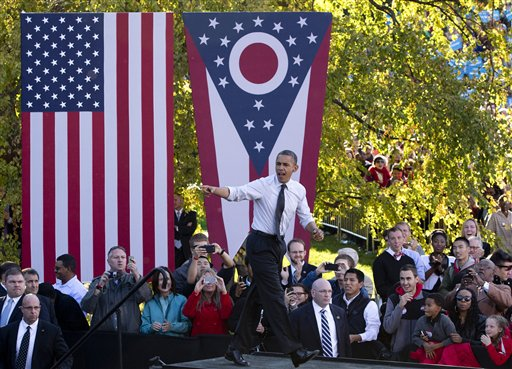 FILE - In this Oct. 9, 2012 file photo, President Barack Obama arrives to speak at The Ohio State University Oval, in Columbus, Ohio. Winning Ohio is complicated, with its variety of voter groups and swinging trends. Diverse in geography, economy and demographics, Ohio is a state that one political scientist says offers a fairly close mirror of the nation. History and electoral math say the swing state is pivotal again this year, and probably crucial for Mitt Romney to win. President Barack Obama is trying to repeat his 2008 victory. (AP Photo/Carolyn Kaster, File)