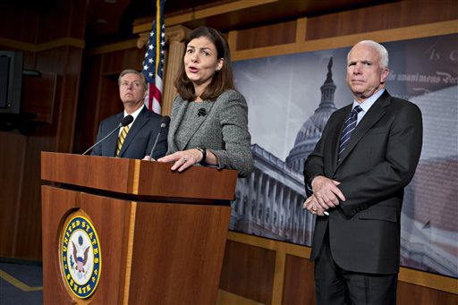 "Sen. John McCain, R-Ariz., right, the ranking member of the Senate Armed Services Committee, right, joined by Sen. Lindsey Graham, R-S.C., far left, and Sen. Kelly Ayotte, R-N.H., center, says he would do all he could to block the nomination of United Nations Amb. Susan Rice to replace Secretary of State Hillary Rodham Clinton because of comments she made after the deadly Sept. 11 attack on the U.S. consulate in Benghazi, at a press conference at the Capitol in Washington, Wednesday, Nov. 14, 2012. President Barack Obama later responded in a news conference saying Rice's critics should ""go after me"" � not her � if they have issues with the administration's handling of the deadly attacks on Americans in Benghazi, Libya. (AP Photo/J. Scott Applewhite)"