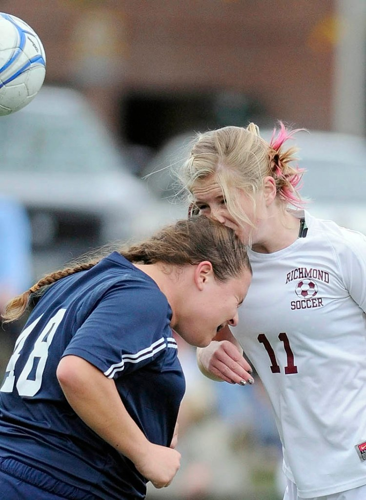 WATCH IT: Richmond High School's Kelsea Anair, right, butts heads with Greenville High School's Tricia Sherman while going for the ball during the Western Maine Class D championship Wednesday in Yarmouth.