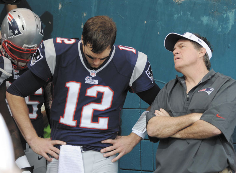 HELP ON THE WAY: New England quarterback Tom Brady, left, and head coach Bill Belichick could see a few important players return to the field when the Patriots play the Houston Texans on Monday. Guard Logan Mankins and defensive end Chandler Jones may play.