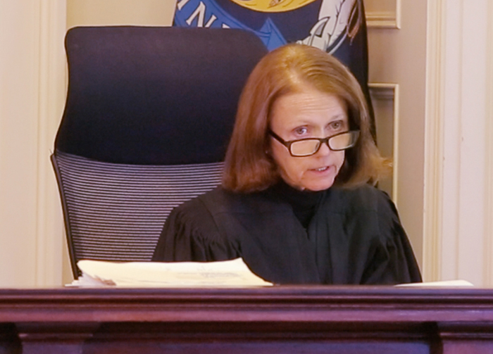 Justice Nancy Mills addresses the court regarding an objection filed by the Portland Press Herald to allow media coverage of jury selection in the trial of Mark Strong at York County Superior Court in Alfred on Wednesday.