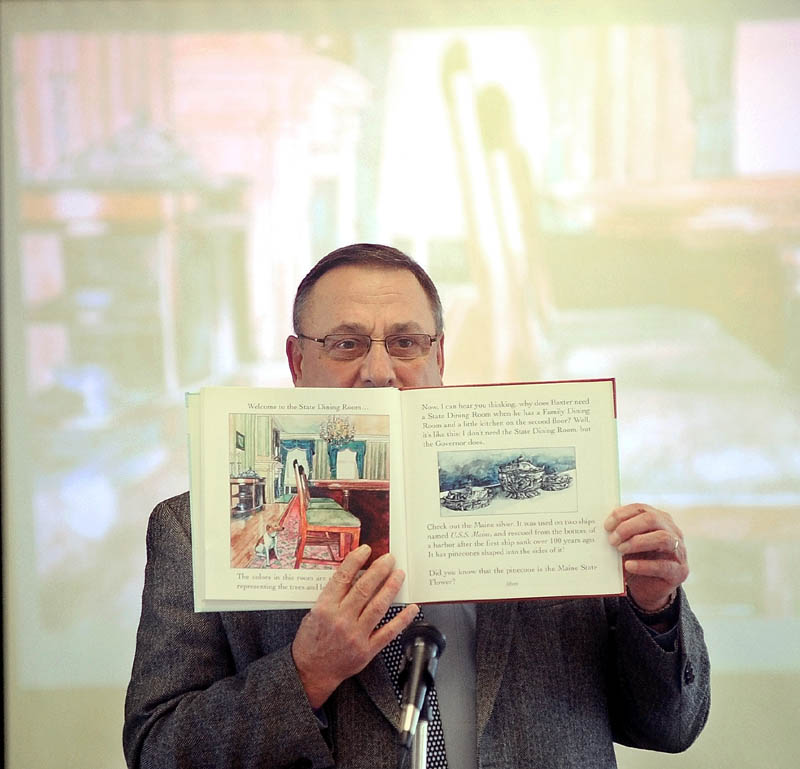 """Gov. Paul LePage reads """"Baxter at the Blaine House"""" to the student body as part of the 2013 Catholic Schools Week celebration at St. John Regional Catholic School on South Garand Street in Winslow on Friday morning."""