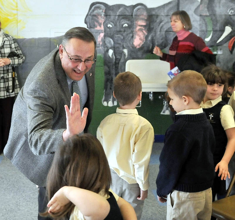 "Gov. Paul LePage greets students after reading ""Baxter at the Blaine House"" to the student body at St. John Regional Catholic School in Winslow on Friday."