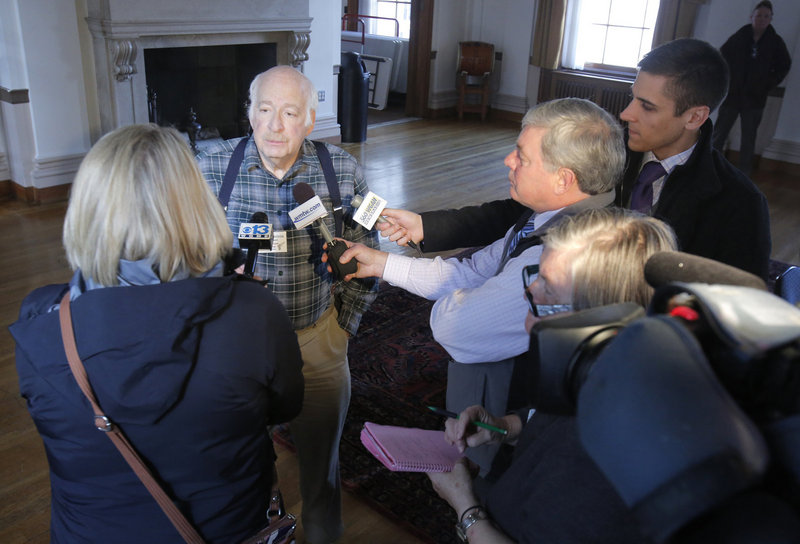 Jeffrey Weinstein, president of the Maine Gun Owners Association, talks with reporters after a news conference at Portland City Hall last month.