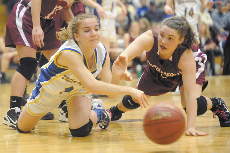 Washburn's Carmen Bragg, left, battles for a loose ball with Haley Murphy of Richmond in the fourth quarter in the Class D girls' basketball state championship game Saturday at the Bangor Auditorium. Washburn beat Richmond for the third straight year, 75-55.