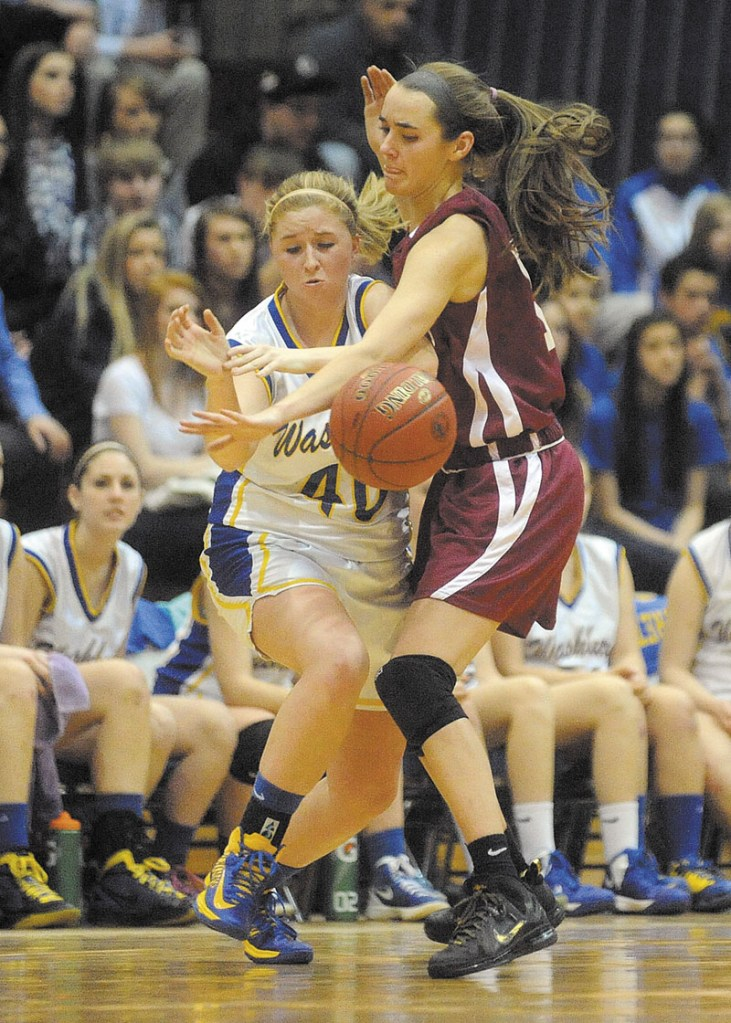 Richmond High School's Jamie Plummer, 15, defends Washburn High School's Nicole Olson, 40, in the fourth quarter of the Class D State Championship game at the Bangor Auditorium Saturday. Washburn defeated Richmond 75-55 for the state title.