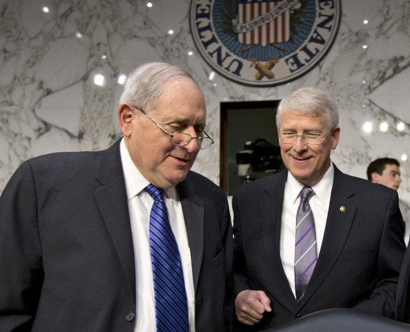 Senate Armed Services Committee Chairman Sen. Carl Levin, D-Mich., left, and Sen. Roger Wicker, R-Miss., talk on Capitol Hill in Washington on Wednesday. A letter addressed to Wicker, believed to be poisoned with ricin, was intercepted at a mail facility outside the capital earlier this week. Levin issued a statement saying an aide in his Saginaw, Mich., office had also received a suspicious-looking letter.
