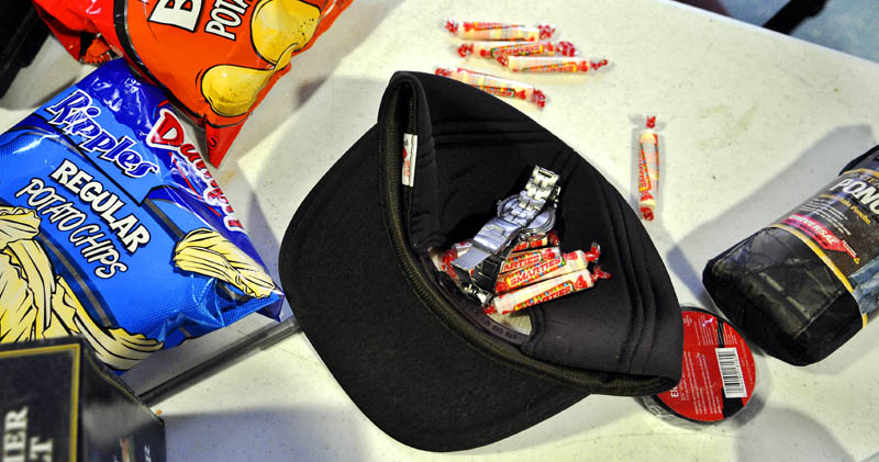 Christopher Knight was apprehended at Pine Tree Camp in Rome on April 4 carrying candy, potato chips, ball cap, poncho and a wrist watch that were all stolen from the camp, according to police.
