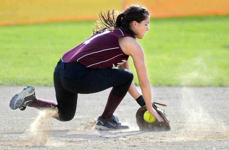 NICE SCOOP: Nokomis Regional High School's Lacey Kent-Webber grabs a ground ball during a against Gardiner Area High School on Monday in Gardiner. The Tigers beat the Warriors 7-4.
