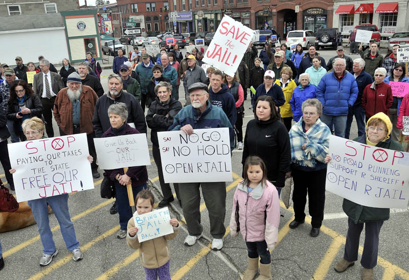 Protesters listen to Sheriff Scott Nichols, Sr., speaks during a protest at the Franklin County courthouse over the Franklin County Jail's reduction to a 72-hour holding facility in Farmington on April 10.
