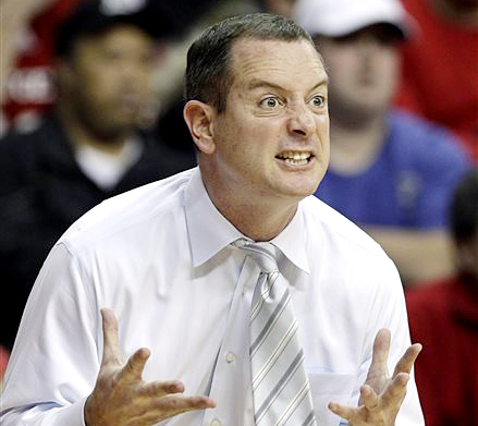 Rutgers coach Mike Rice reacts to play during a game against Connecticut in Piscataway, N.J., in this 2012 photo. The airing of a videotape of Rice using gay slurs, shoving and grabbing his players and throwing balls at them in practice led to his firing on Wednesday.