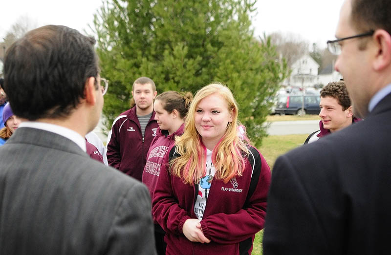 Student protest leader Lauren Umberhind, a senior at Richmond High School, center, chats with the two Democratic legislators that represent her town, Rep. Seth Berry, left, and Sen. Seth Goodall, before marching around the State House on Friday. Goodall mentioned that he also attended Richmond High School.