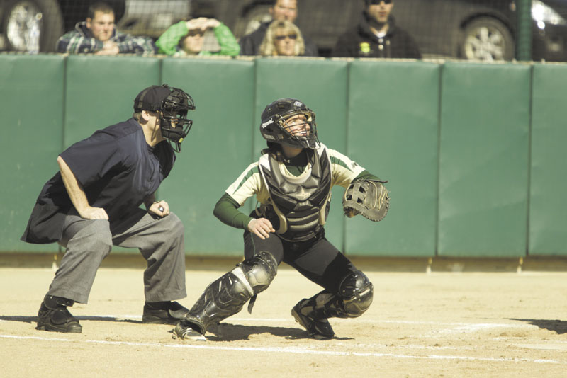 CATCHING ON: Former Maranacook Community School catcher Heidi Shaw has become a slap-hitting switch hitter at Husson University.