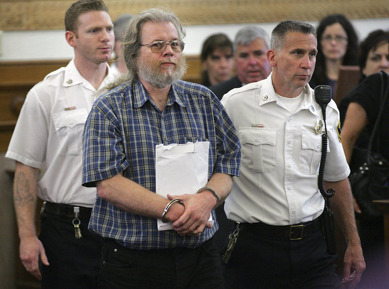 Convicted rapist Gary Irving is led into Norfolk Superior Court in Dedham, Mass., Thursday, May 23, for sentencing. Irving was sentenced to 36 to 40 years in prison for raping three women in Massachusetts, more than three decades after he fled the state and began living a secret life in Maine. (AP Photo/The Patriot Ledger, Gary Higgins, Pool)