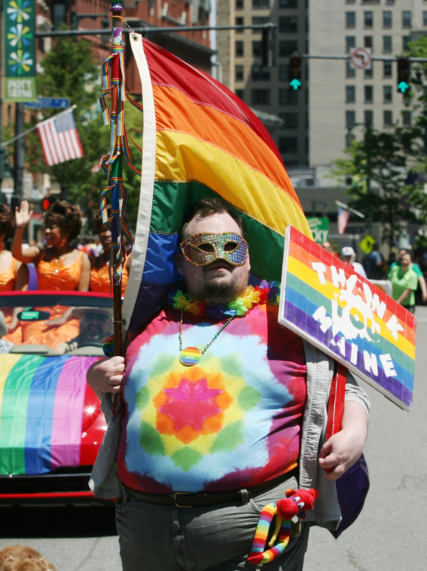 John Paschal, of Sanford, marches Saturday during the annual Pride Parade in Portland.