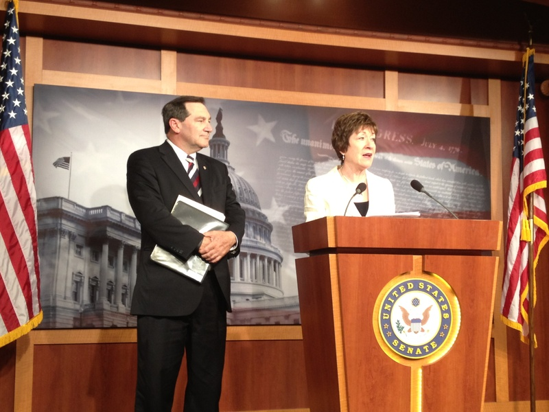 Maine Sen. Susan Collins, a Republican, is joined by Democratic Sen. Joe Donnelly of Indiana on Wednesday during a news conference to discuss their bill to change the definition of full-time employment in President Obama's Affordable Care Act.