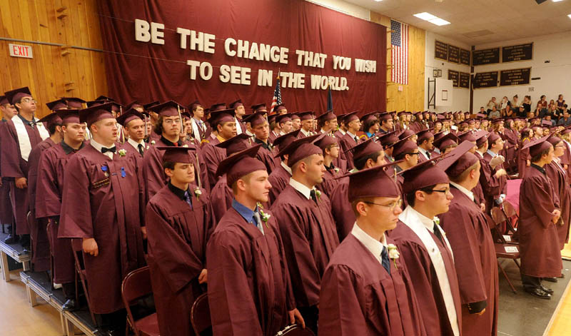 Nokomis High School's class of 2013 take their seats during commencement ceremonies in Newport on Friday.