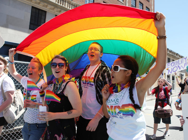 From left, Sandra Curry, Cassia Tirrell, Nathaniel Curry and Alizha Gagnon march during the annual Pride Parade in Portland on Saturday.