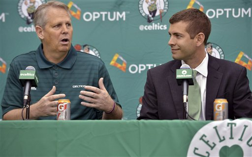 Boston Celtics general manager Danny Ainge, left, speaks alongside new head coach Brad Stevens, right, during a news conference where Stevens was introduced Friday, July 5, 2013, at the NBA basketball team's training facility in Waltham, Mass. Stevens twice led the Butler Bulldogs to the NCAA title game. He replaces Doc Rivers, who was traded to the Los Angeles Clippers. (AP Photo/Josh Reynolds)
