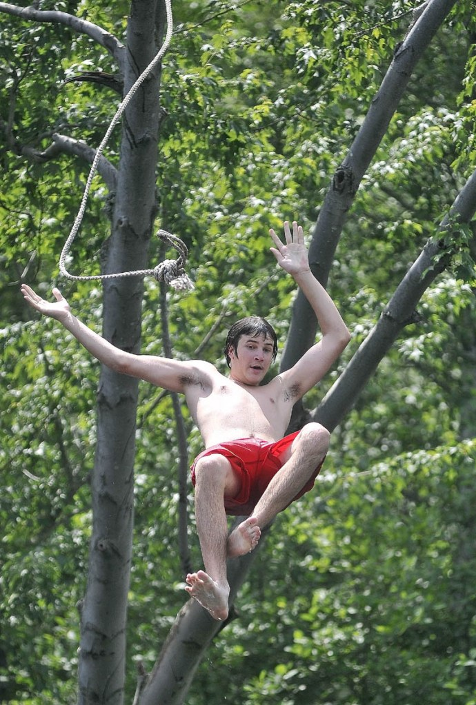 Kenneth Frappier, 15, of Fairfield, takes the plunge from a rope swing in to the Messalonskee Stream in Waterville near North Street on Saturday.
