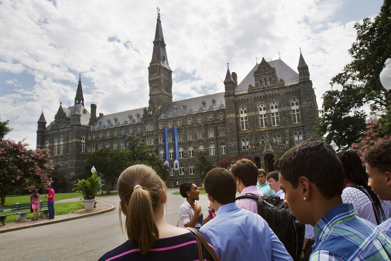 Prospective students tour Georgetown University's campus in Washington, Wednesday, July 10, 2013. The defeat of a student loan bill in the Senate on Wednesday clears the way for fresh negotiations to restore lower rates, but lawmakers are racing the clock before millions of students return to campus next month to find borrowing terms twice as high as when school let out. (AP Photo/Jacquelyn Martin)