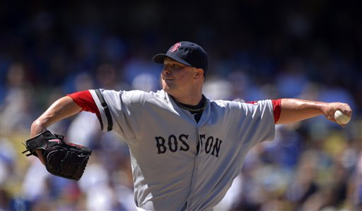 WELL DONE: Boston Red Sox starting pitcher Jon Lester pitched 7 1/3 innings, allowed one run, struck out six, walked four and gave up three hits Saturday against the Los Angeles Dodgers on Saturday in Los Angeles.