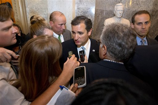 Sen. Ted Cruz, R-Texas, speaks to reporters on Capitol Hill Wednesday after ending his marathon speech on the Senate floor.