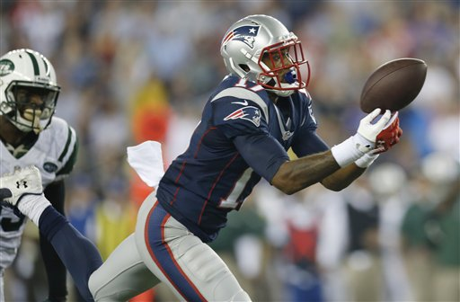 HANG ON: New England Patriots wide receiver Aaron Dobson tries, but can't pull in a pass from Tom Brady during the second quarter of the Patriots' 13-10 win over the New York Jets on Thursday in Foxborough, Mass.