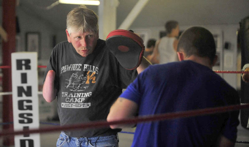 Skeet Wyman works the pads with Brandon Berry, who travels three days a week about 225 miles round trip to train at Wyman's Boxing Club in Stockton Springs.