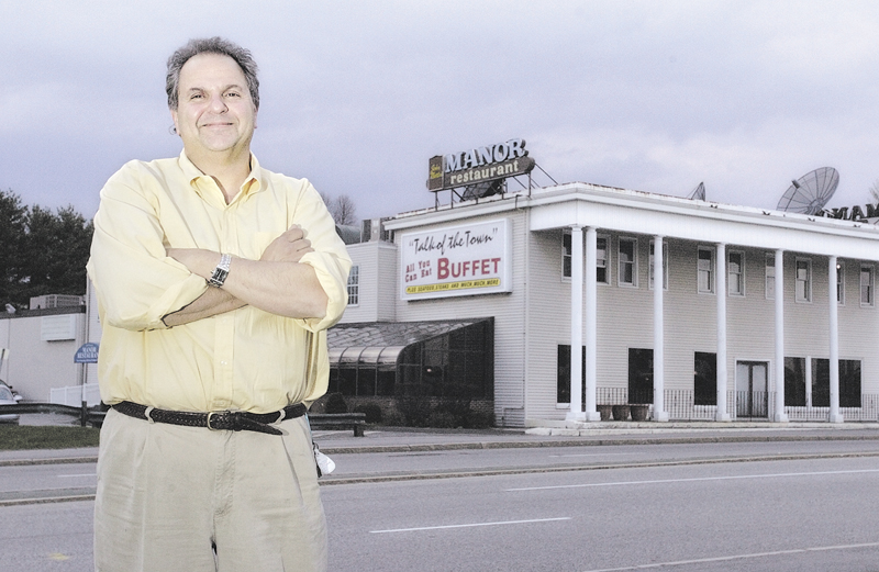 Peter Martin stands in front of the John Martin's Manor Restaurant on College Avenue in Waterville in 2005, shortly before selling the establishment to a Georgia company.