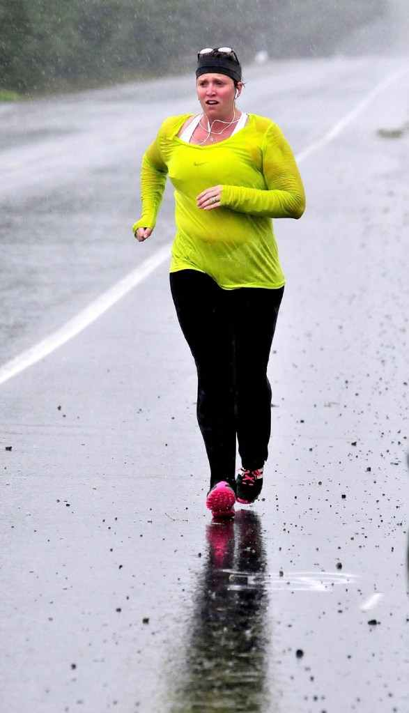 """Jana White was soaked after running in a downpour through Norridgewock on a rainy Labor Day. Asked about the running conditions, White said, matter-of-factly, """"It is what it is."""""""