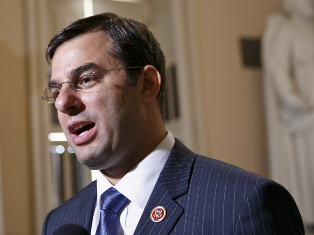 In this July 24, 2013 file photo, Rep. Justin Amash, R-Mich. speaks on Capitol Hill in Washington. Hard-line House Republicans are dismissing dire warnings that a government default would wreck U.S. and world economies as another case of hyperbole from an Obama administration that cried wolf about the likely impacts of automatic spending cuts and partially shutting down the government.