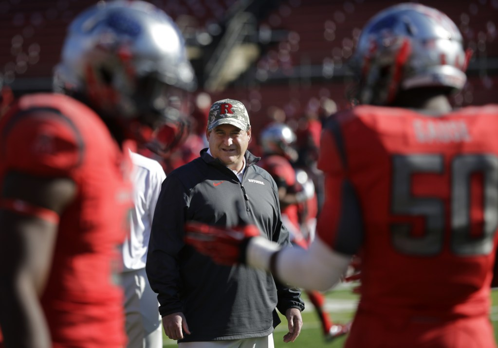 Rutgers defensive coordinator Dave Cohen watches his players warm up before an NCAA college football game against Cincinnati in Piscataway, N.J., on Saturday. A player who left the team says Cohen used two profane terms in the study hall in front of teammates and an academic adviser, who reported the issue, according to the website NJ.com.