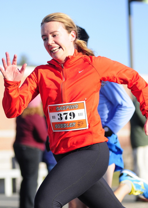 WOMEN'S WINNER: Anna Ackerman was the first female finisher at the Gasping Gobbler 5k run which began and finished at Cony High on Thursday November 28, 2013 in Augusta. There were over 400 registrants in the event that gave turkeys and other Thanksgiving dinner groceries as prizes.