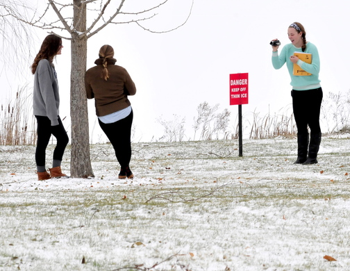 WINTER: Colby College students work on a class project out in the snow near barely frozen Johnson Pond on Tuesday. Katherine Mackey shots the photos of her friends Eleanor Ozburn, left, and Sarah Shimer.