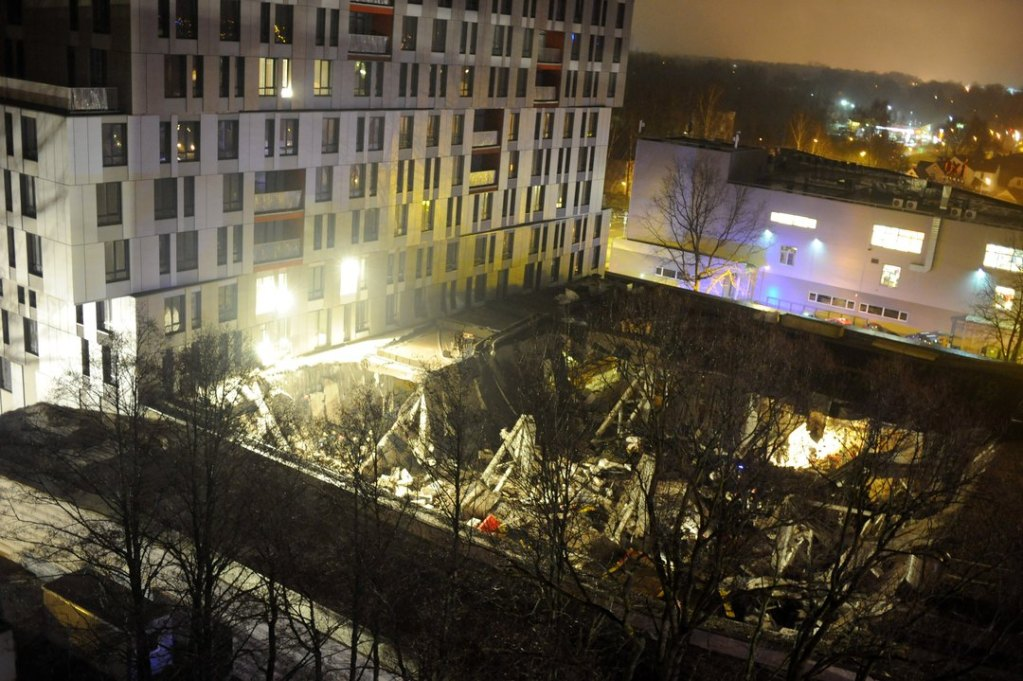A lview of the collapsed Maxima supermarket in Riga, Latvia, late Thursday.Rescue workers periodically turned off all equipment and asked relatives of missing people to call so that they can pinpoint ringing phones, rescue service spokeswoman Viktorija Sembele said.