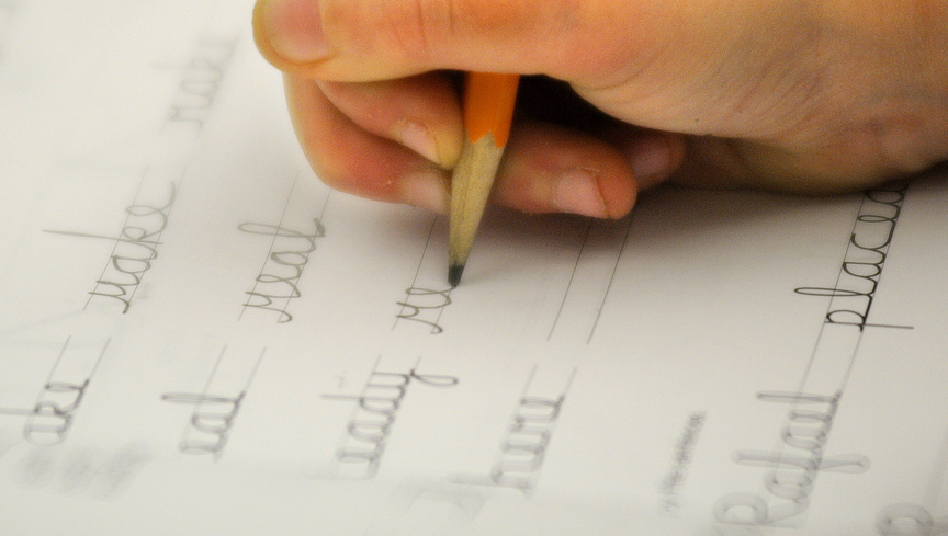 UP close: A Chelsea Elementary third-grader works on a cursive lesson during a recent class.