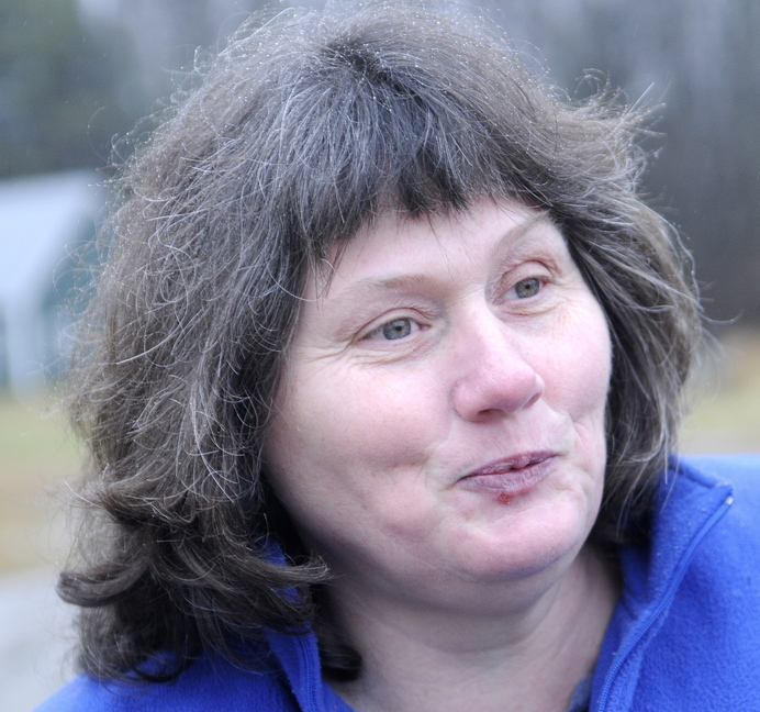 Close Call: Becky Berlew of Pittston credits Kennebec Journal carrier Troy Rundstrom, of Dresden, with rescuing her Monday after the car she was driving rolled off the road and filled with water during an early morning accident in Dresden.