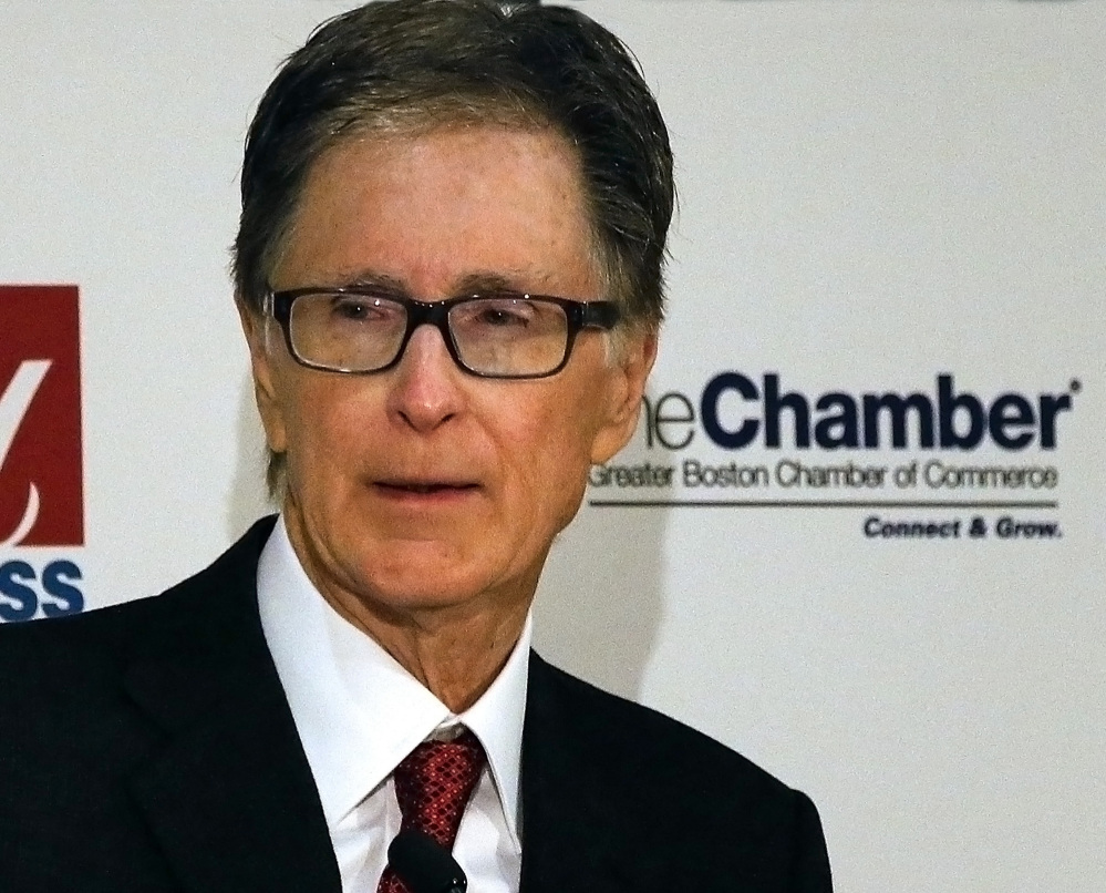 """Boston Red Sox owner John Henry speaks at the Greater Boston Chamber of Commerce breakfast meeting at the Mandarin Oriental Hotel in Boston, Wednesday, Jan. 8 2014. Henry, who recently purchased The Boston Globe, said Wednesday at the breakfast that the newspaper would work to remain """"aggressively relevant"""" in the changing media environment."""